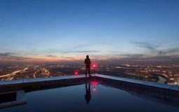 Image of man standing overlooking the skyline, represents 1Up's commitment to visionary thinking and unafraid of challenges